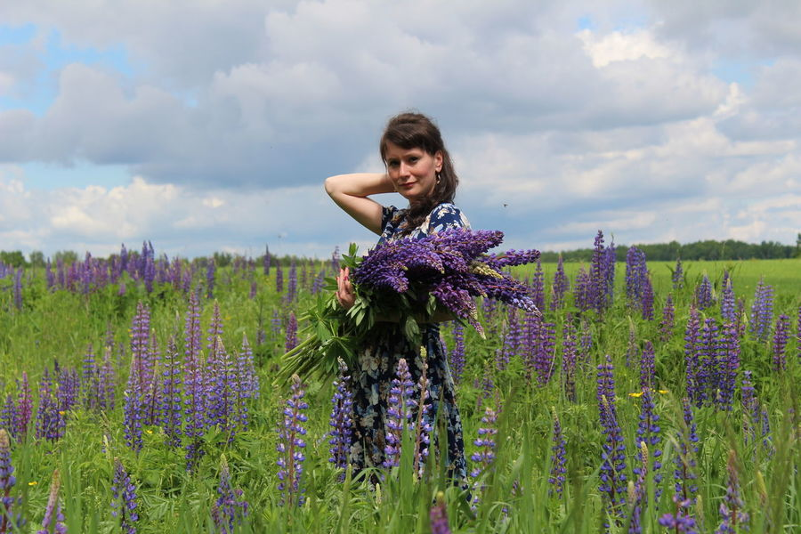 Agriculture Beautiful Woman Beauty In Nature Cloud - Sky Day Field Flower Fragility Growth Landscape Lavender Lavender Colored Nature One Person Outdoors Plant Purple Real People Rural Scene Russian Girl Sky Smiling Standing Young Adult Young Women