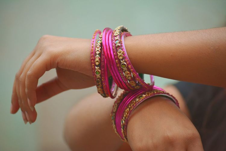 Midsection of woman wearing bangles