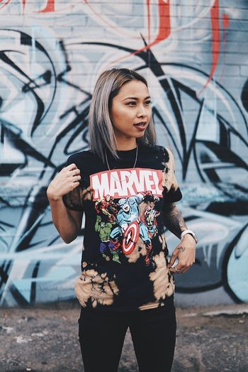 She a fan 💕 Urban Lifestyle Urbanphotography Candid Portrait One Person Graffiti Lifestyles Real People Front View Casual Clothing Young Adult Wall - Building Feature Street Art Outdoors City Women