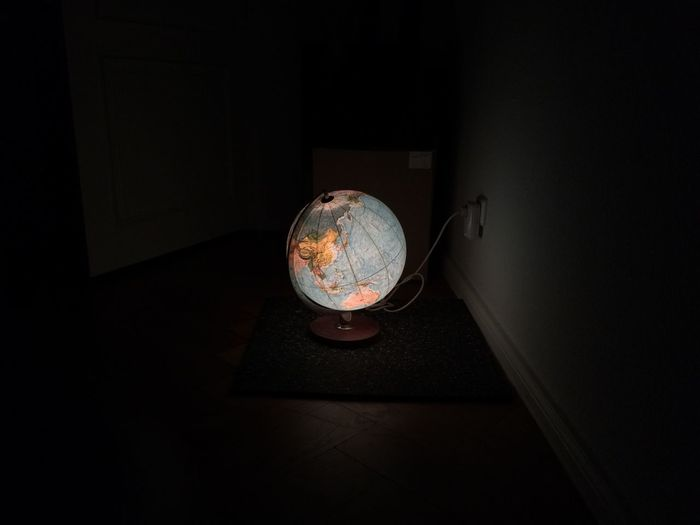High angle view of illuminated globe at home