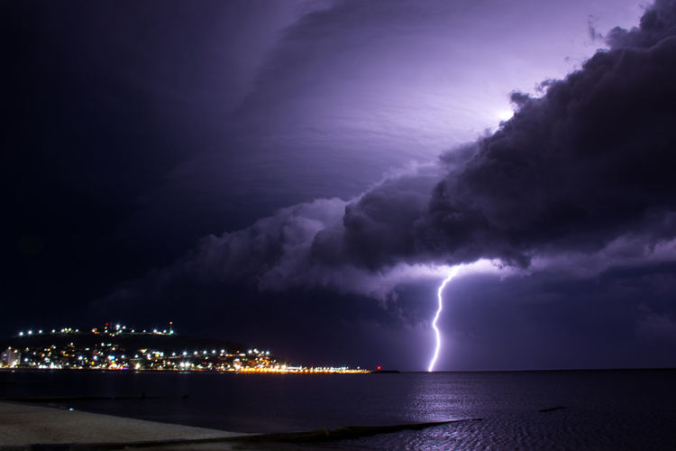 Lightning Night Sea Thunderstorm Storm Power In Nature Water No People Illuminated Storm Cloud Environment Nautical Vessel Forked Lightning Awe Nature Outdoors Beach Sky Beauty In Nature Cityscape