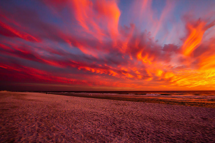 Scenics - Nature Sky Water Sunset Beauty In Nature Sea Cloud - Sky Land Beach Tranquility Horizon Tranquil Scene Environment Nature Horizon Over Water Orange Color Landscape Sand No People Outdoors Romantic Sky