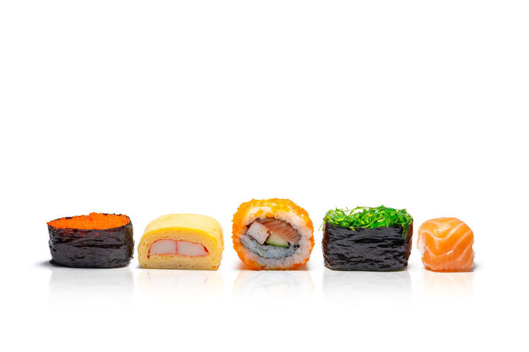 High angle view of sushi in plate against white background