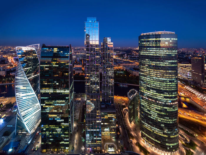 Skyscrapers of Moscow City business district at dusk. Picture taken from the top (60th floor) of the Federation Tower in Moscow, Russia. Moscow City Skyscrapers Aerial View Architecture Building Exterior City City Life Cityscape Dusk Financial District  Illuminated Modern Night No People Office Office Building Exterior Sky Skyscraper Tall - High Tower Travel Destinations