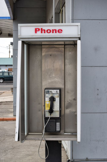 Pay phone at a gas station. Close-up Communication Connection Convenience Day No People Old-fashioned Outdoors Pay Phone Technology Telecommunications Equipment Telephone Telephone Booth Telephone Receiver
