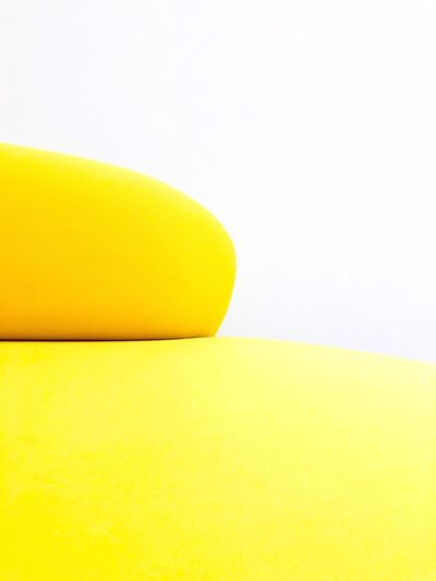 This is a Sofa by Vitra Details Textures And Shapes Details Detail Soft Surface Textured  No People Object Minimalist Minimalism Furniture Photography Furniture Design Vitra Furnitures Yellow Indoors  Copy Space Studio Shot Still Life Close-up No People Single Object Freshness White Background