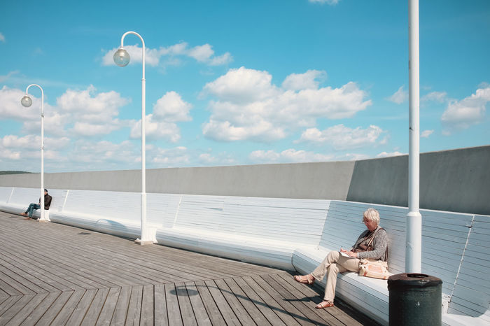 Bench Cloudscape Molo Poland Retired Sopot, Poland Street Lamp Urban Geometry Visual Stories Blue Sky Cloud - Sky Clouds Dockside Lamppost Old Woman Outdoors Polish Reading & Relaxing Reading A Book Real People Sitting Sky Sopot Streetphotography Woman Portrait Your Ticket To Europe