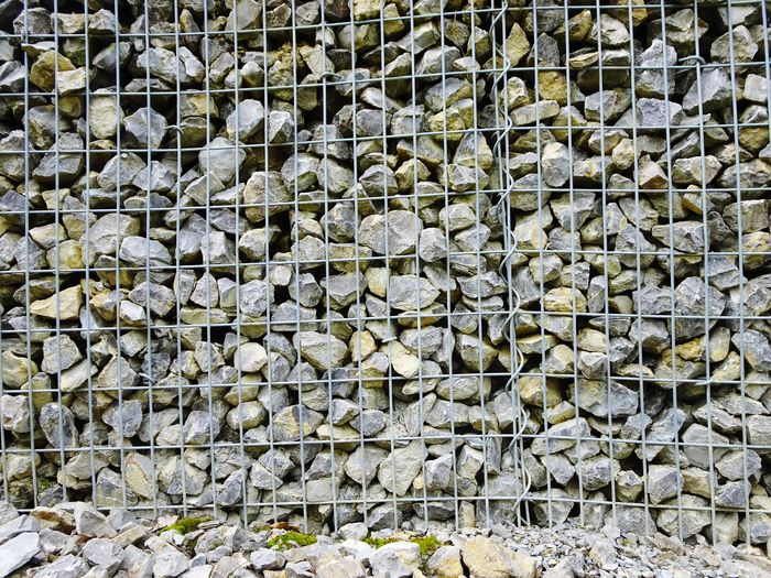 Stones Full Frame Backgrounds No People Day Large Group Of Objects Abundance Pattern Outdoors Arrangement Wall - Building Feature In A Row