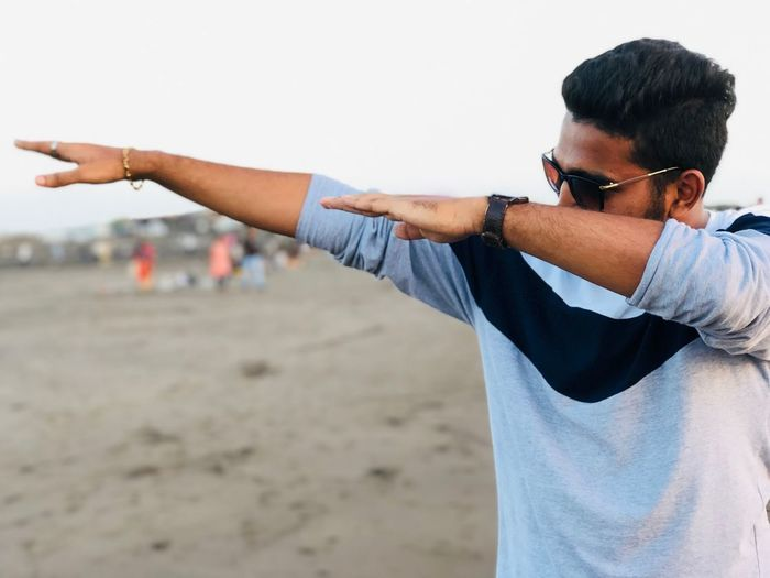 EyeEm Selects Men Human Body Part One Person Human Arm Land Casual Clothing Outdoors Human Hand Lifestyles Young Men Hand Focus On Foreground Limb Body Part Young Adult Beach Leisure Activity Day Nature Real People