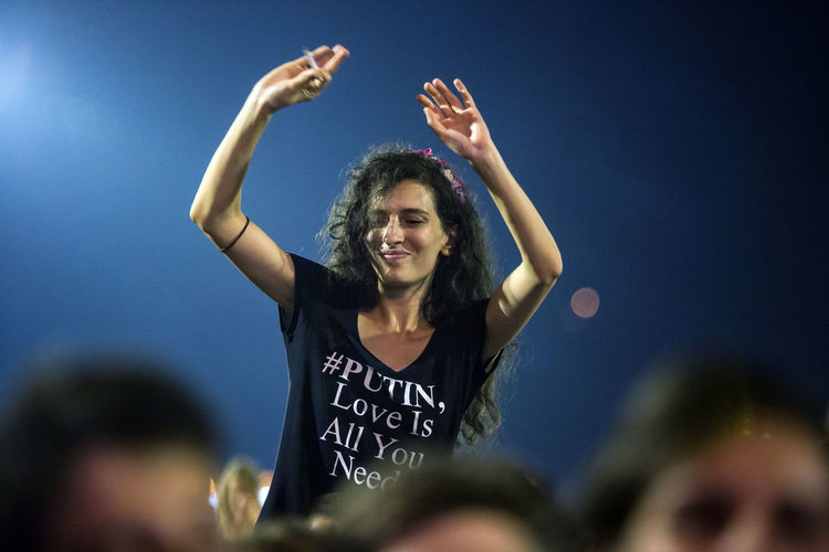 Guca Trumpet Festival Serbia Adult Arms Raised Blue Cheerful Day Event Excitement Fan - Enthusiast Guca Human Body Part Koncert Lifestyles Looking At Camera One Person Outdoors People Portrait Press Photography Real People Reportage Sky Women Young Women