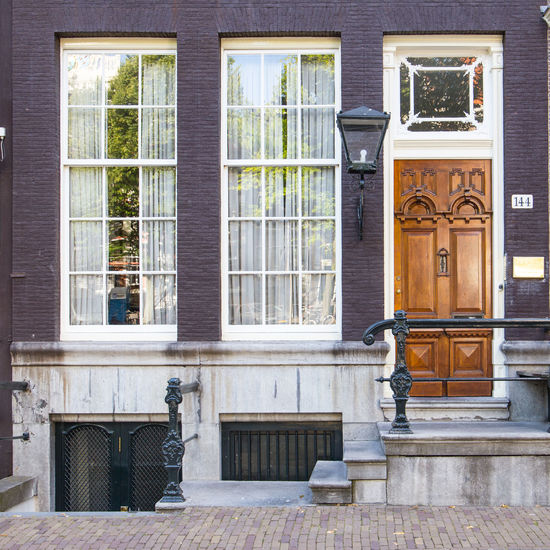 Amsterdam Entrance Netherlands Architecture Building Building Exterior Built Structure Canal Houses City Day Door Dutch Architecture Dutch Houses Entrance Food And Drink Front Door Front Stoop Glass - Material Holland Home House Luxury No People Outdoors Residential District Tourism Victorian Style Wealth Window
