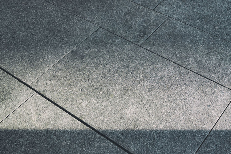 Berlin, Germany, August 04, 2018: Full Frame Close-Up of Light and Shadow Effect on Outdoors Tiled Flooring Berlin Germany 🇩🇪 Deutschland Horizontal Backgrounds Color Image Concrete Day Flooring Footpath Full Frame Geometric Shape Gradual Gray High Angle View No People Outdoors Pattern Shadow Shape Sidewalk Stone Subtle Textured  Tile Tiled Floor