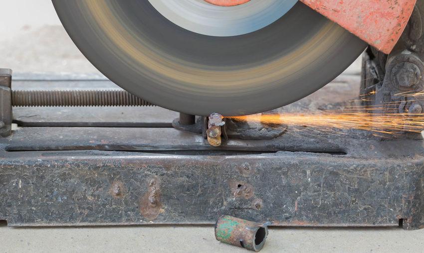 Close-up of grinder cutting metal
