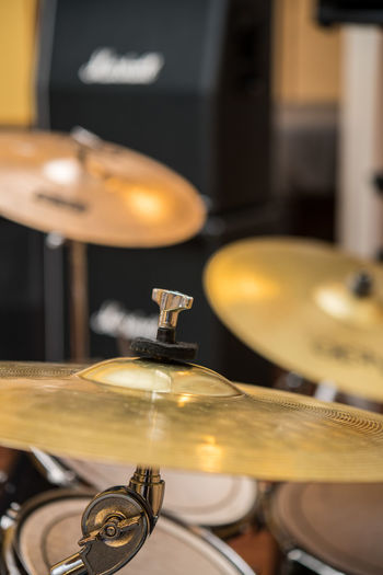Cymbal close up in drum kit Bronze Golden Sound Stage Studio Arts Culture And Entertainment Beat Close Up Close-up Cymbal Day Drum - Percussion Instrument Drum Kit Drumstick Indoors  Metal Music Musical Instrument No People Percussion Record Player Needle Rythm Selective Focus