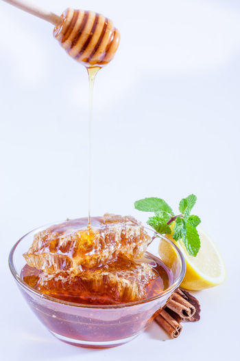 Close-up of drink on table against white background
