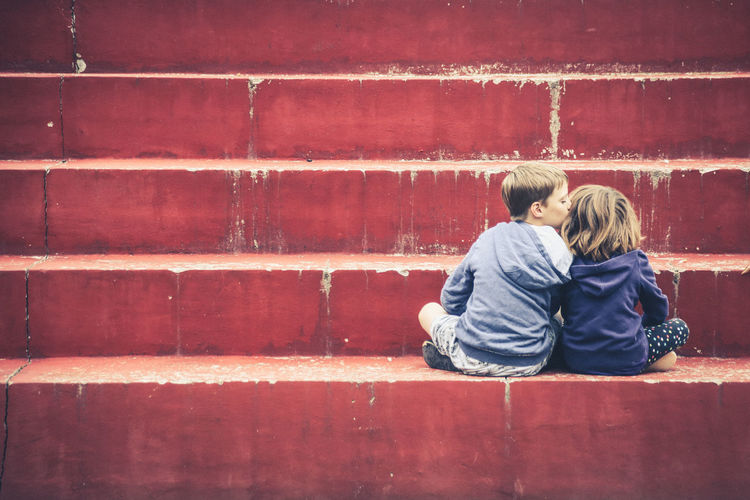 Two People Togetherness Child Childhood Bonding Real People Love Sitting Emotion Positive Emotion People Casual Clothing Males  Females Wall - Building Feature Leisure Activity Wall Brick Outdoors Care Hairstyle Innocence Brother & Sister Affection Tenderness My Best Photo