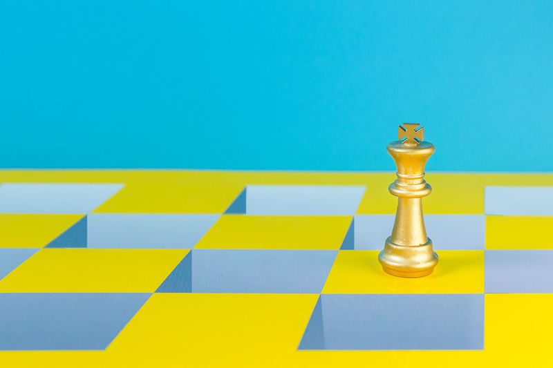 Close-up of chess against blue background