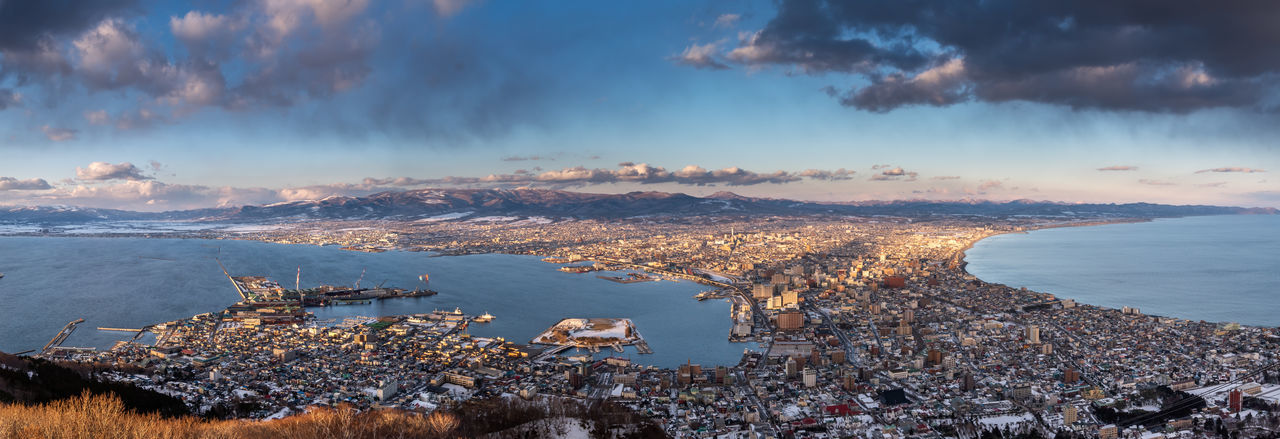 High angle view of city by sea during winter