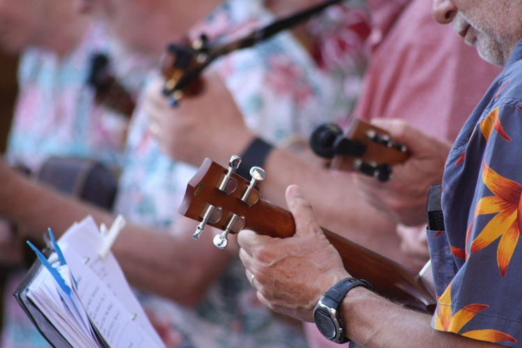 Midsection of people playing musical instruments