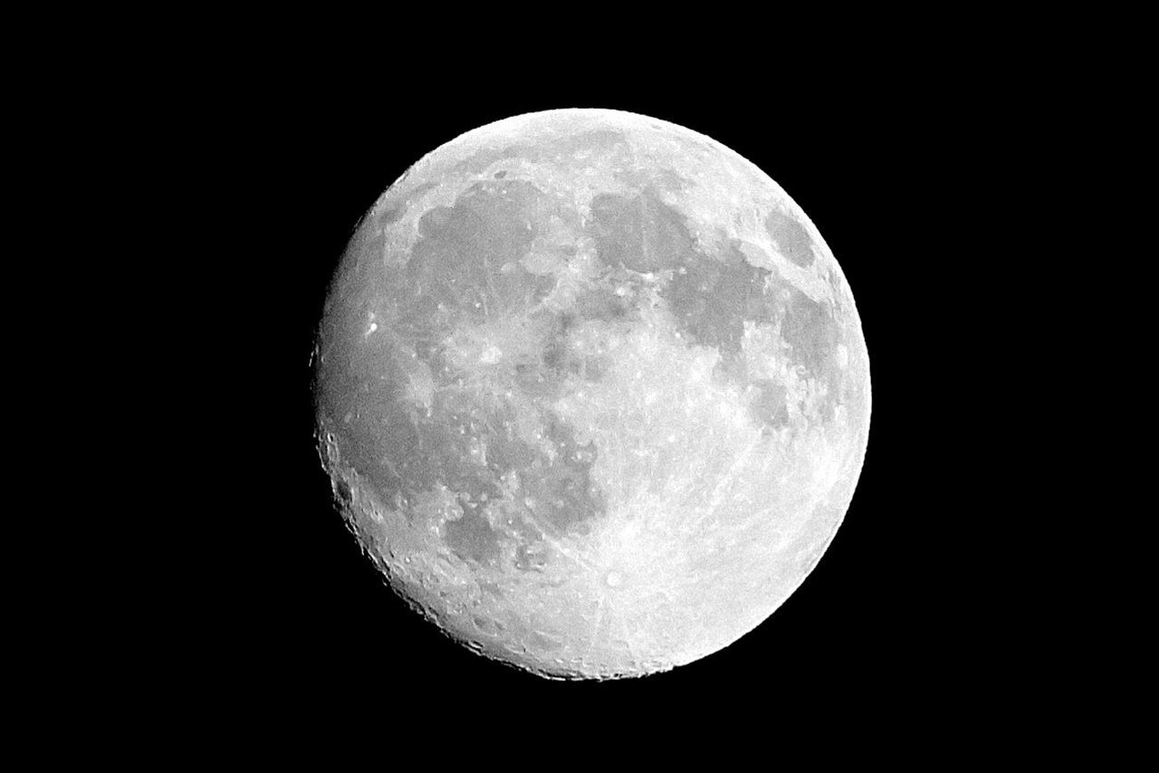 LOW ANGLE VIEW OF MOON OVER DARK SKY