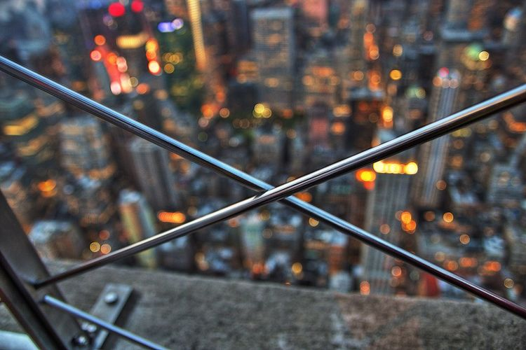 Close-up of railing in city