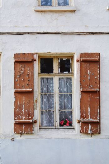 Old window with open shutters