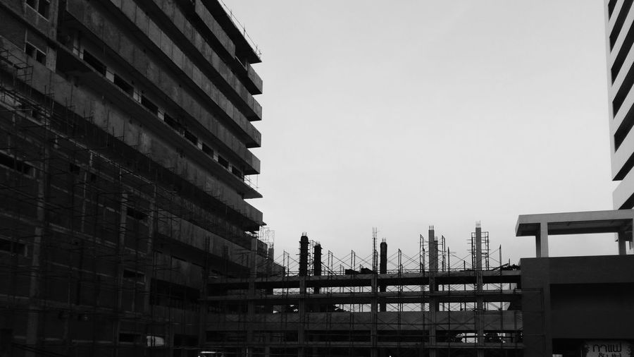 Low Angle View Of Incomplete Buildings At Construction Site