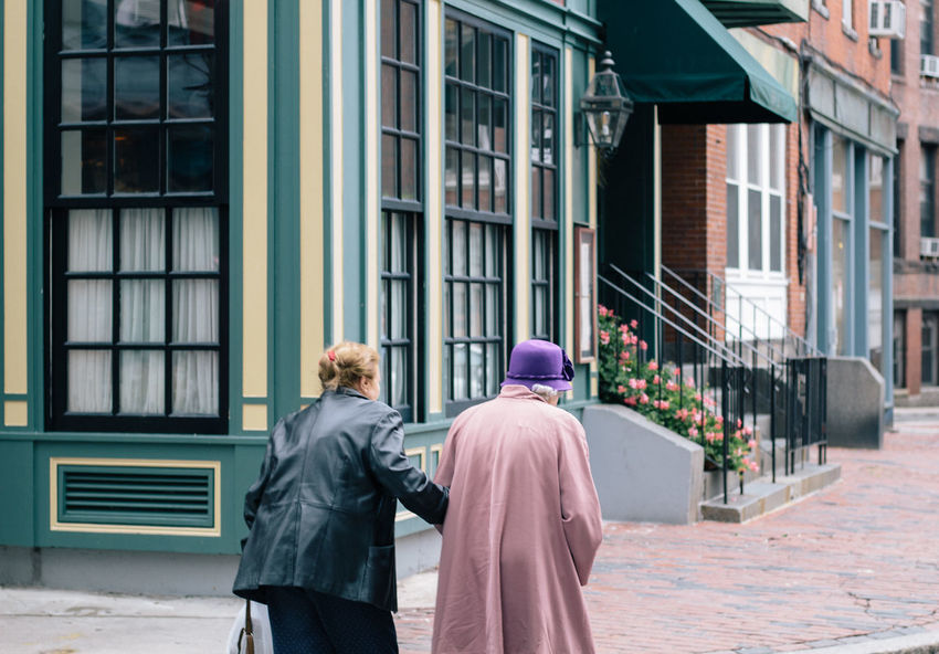 Architecture Boston Brick Building Exterior City Cobblestone Crossing The Street Day England Flowers Old Lady Outdoors People Queen Queen Elizabeth  Real People Rear View Togetherness Two People Walking Women