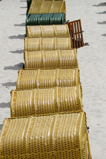 High angle view of hooded beach chairs at beach