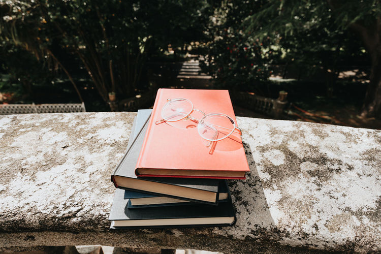 High angle view of open book against trees
