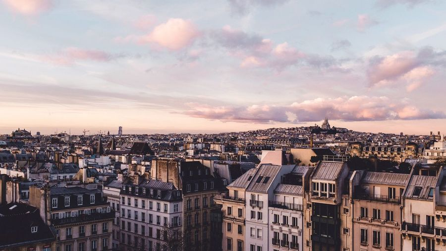 Parisian roofs Parisian Rooftop Roofs Paris Montmartre EyeEm Selects Architecture Building Exterior Built Structure Cityscape Crowded City Residential Building Sky Cloud - Sky Sunset Residential  Day Outdoors