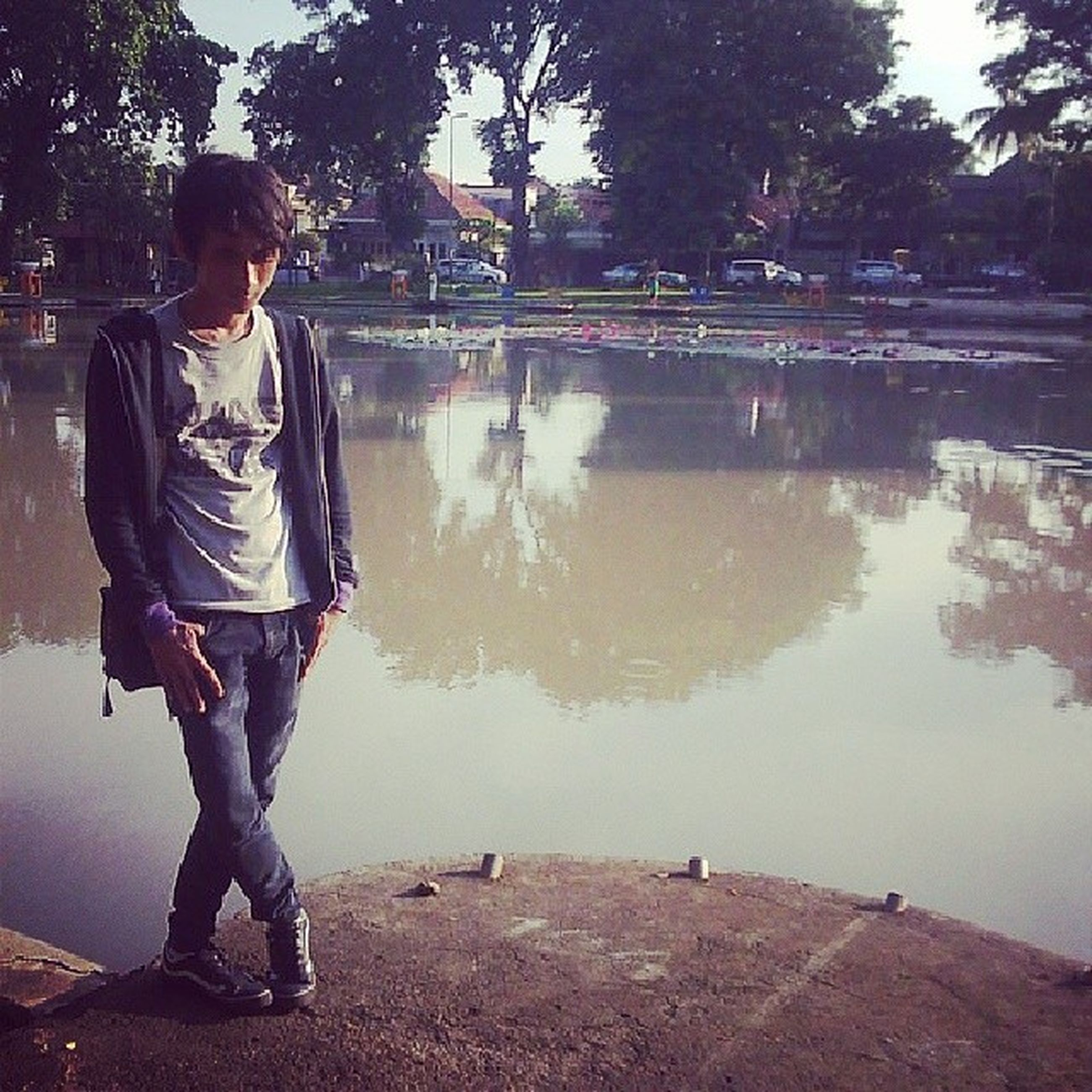 water, lifestyles, leisure activity, casual clothing, full length, boys, tree, standing, men, childhood, rear view, lake, girls, person, elementary age, day, togetherness