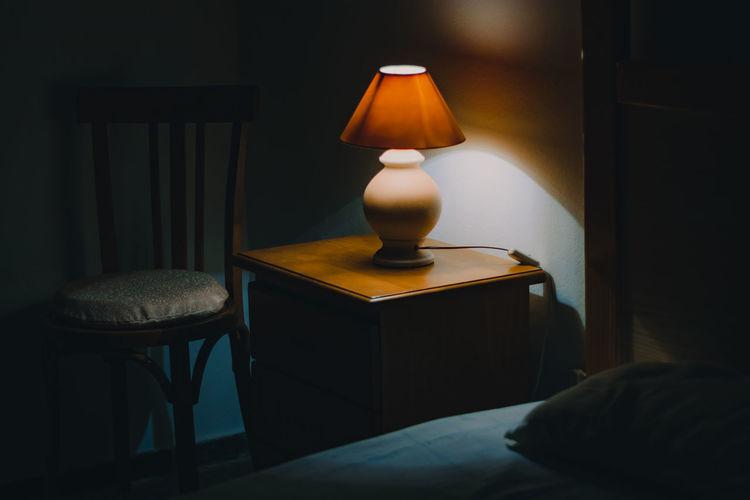 Illuminated electric lamp on table