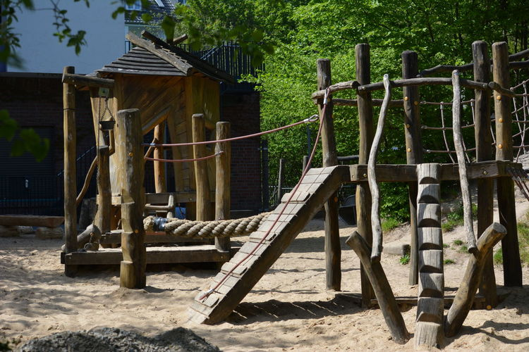 Empty chairs on wooden post at playground