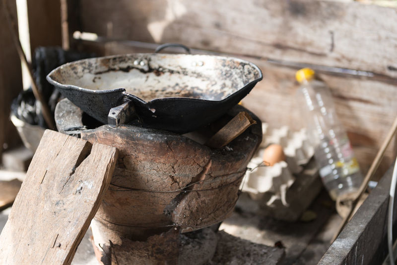 No People Focus On Foreground Container Household Equipment Metal Wood - Material Close-up Day Nature Outdoors Burning Kitchen Utensil Old Wood Appliance Still Life Heat - Temperature Preparation  Pan