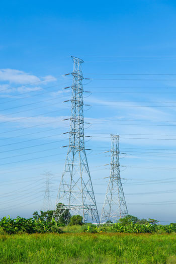 Low Angle View Of Electricity Pylons Against Sky