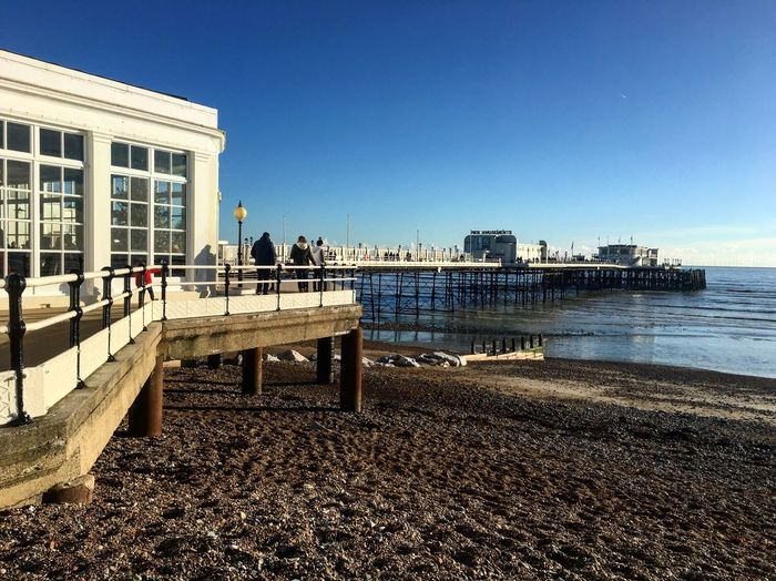 Beach Seaside Pier Built Structure Architecture Building Exterior Real People Day Travel Destinations Water Sky Outdoors Sunlight Clear Sky City