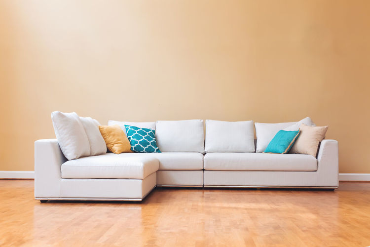 View of sofa against wall home