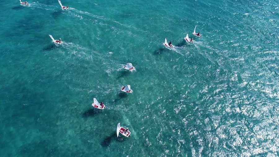 High angle view of people sailing boats on sea