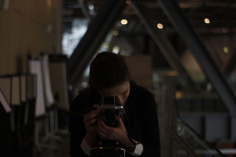 Woman photographing in workshop