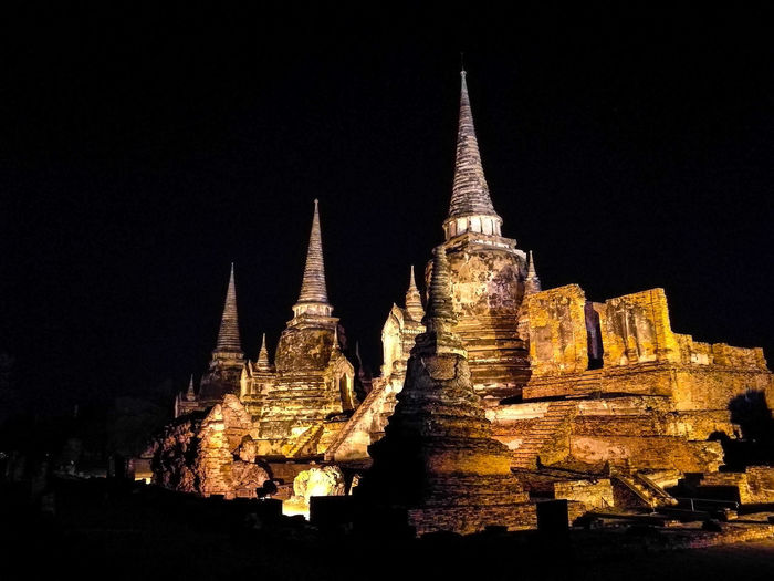 Midnight in Ayutthaya Night Architecture No People History Travel Destinations Outdoors Illuminated Cityscape Building Exterior Sky Ancient Civilization City Ancient History Travel Ancient Thailand🇹🇭 Ayutthaya Historic Park Ayutthaya Cultures Old Ruin Architecture Architectural Feature Religion Buddhist Temple Arts Culture And Entertainment