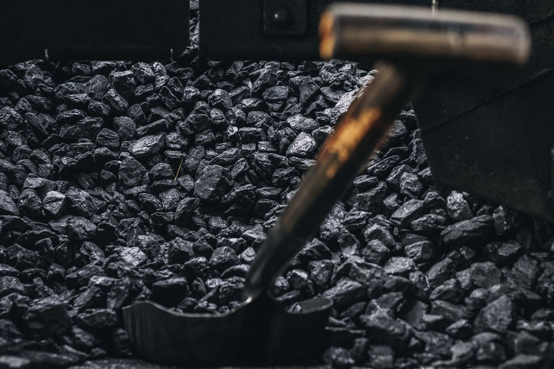 Close-Up Of Spade Amidst Coal