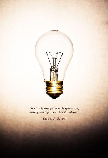 Illuminated electric lamp against white background