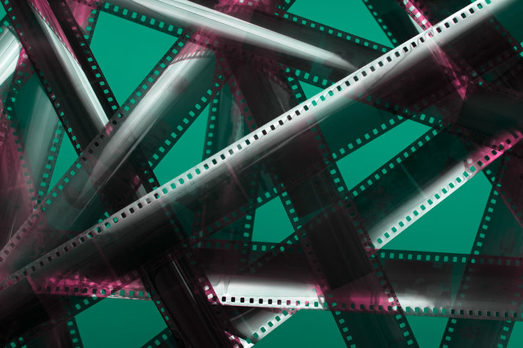 Analog film strip. Tangled movie plot Arts Culture And Entertainment Backgrounds Film Reel Full Frame Film Industry Pattern Connection Green Color Camera Film Technology Design Equipment Shape Abstract Photography Themes 35mm Laboratory Creative Creation Intersection Detective Content Media Analog Negative Photography