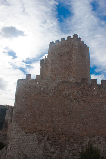 Architecture Blue Building Exterior Built Structure Castle Castle Cloud - Sky Day Famous Place Fort Fortified Wall History International Landmark Low Angle View Medieval Old Buildings Old Castle Outdoors Sky Sky And Clouds Stone Tall - High The Past Tourism Travel Destinations