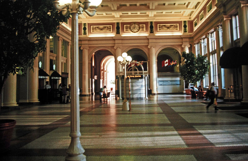 Vancouver railway station Architecture People Men Day Marble Floor Illuminated Canada Indoors  Indoor Plants Arch Indoor Trees Architectural Column Railway Stations A Taste Of Canada Vancouver Station Chequered Floor Hidden Lighting