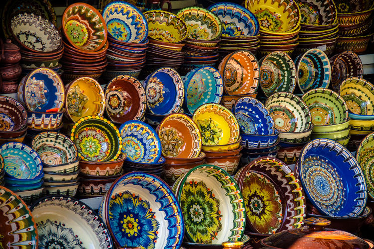 Arts And Crafts Bazaar Bulgaria Choice Cultures For Sale Large Group Of Objects Market Market Stall Multi Colored Ornaments Pottery Retail  Tourism Travel Destinations