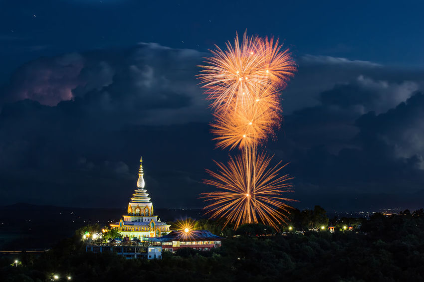 Chiang Mai | Thailand Architecture Arts Culture And Entertainment Building Exterior Built Structure Celebration City Cityscape Cloud - Sky Exploding Firework Firework - Man Made Object Firework Display Illuminated Long Exposure Night No People Outdoors Place Of Worship Religion Sky Spirituality Travel Destinations