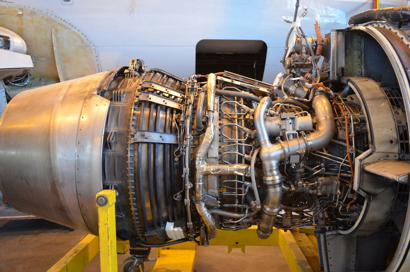 Open aircraft engine Aircraft Aircraft Maintenence Close-up Engine Engineering Future Hangar Horizontal Indoors  Industry Machine Part Machinery Manufacturing Equipment Mode Of Transport No People Open Service Tech Technology Transportation Tubes Yellow First Eyeem Photo