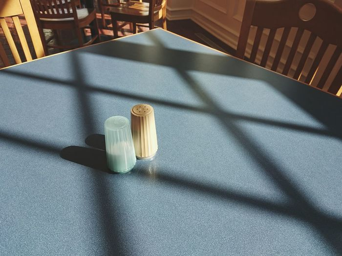 High angle view of salt shakers on table